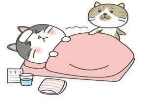 布団で寝込む猫